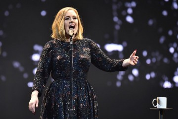 Adele pays tribute to brussels victims