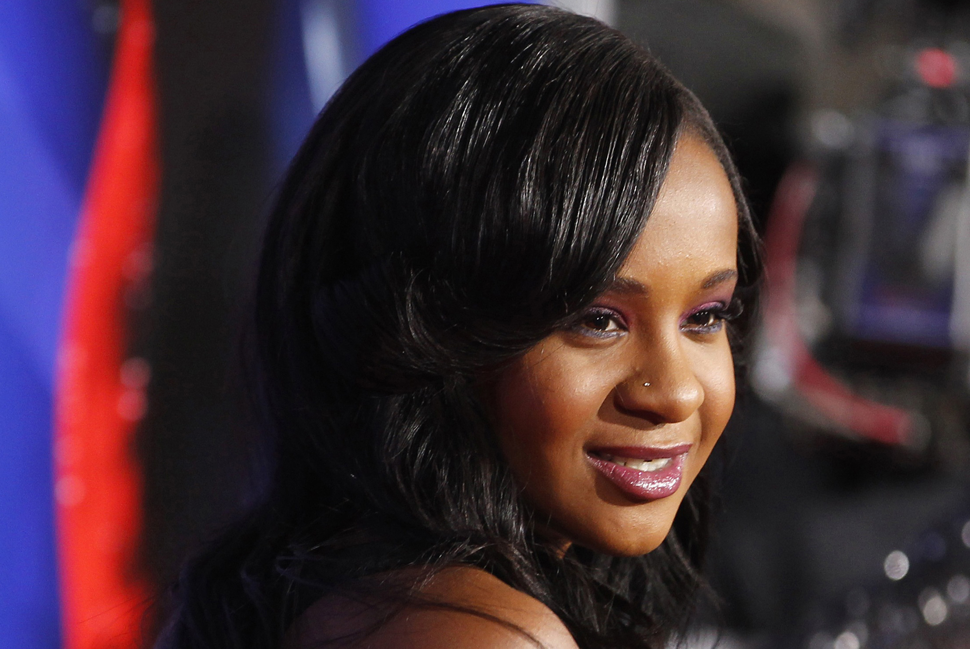 """Bobbi Kristina Brown, daughter of the late singer Whitney Houston, poses at the premiere of """"Sparkle"""" in Hollywood, California, in this file photo taken August 16, 2012. Brown, daughter of late pop star Whitney Houston and of Bobby Brown, was rushed to the hospital after she was found unresponsive in the bathtub of her home in Roswell, Georgia, CNN reported on Saturday, citing police.   REUTERS/Fred Prouser/Files   (UNITED STATES - Tags: ENTERTAINMENT)"""